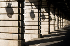 Shadows on Bercy bridge - Paris. Perspective with lights shadows on a bridge in Paris Royalty Free Stock Photo