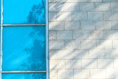 Shadows on blue window glass and wall. In sunlight, abstract background and design material royalty free stock photos