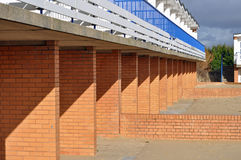 Shadows and bricks. Shadows cast over a red brick wall Stock Photo