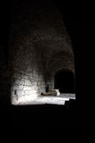 Shadows in Cellar. Medieval stone cellar interior in Maasi fortress Saaremaa. The building of the foundation of Maasilinn started in 1345. Major reconstruction royalty free stock photos