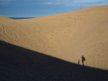 Shadows of child and adult hiking in dunes Royalty Free Stock Photos