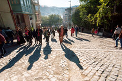Shadows on cobbled stones from rushing people during city festival Tbilisoba Royalty Free Stock Photography