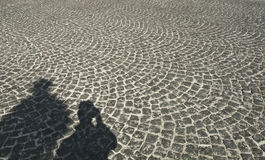 Shadows on the Cobblestone Road. Self-portrait on a Cobblestone Road in Paris Stock Photos