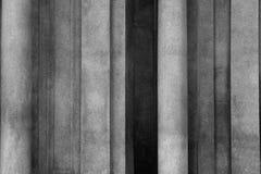 Shadows between Columns. Over a building facade Stock Photos