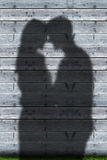 Shadows of couple embracing Royalty Free Stock Photo