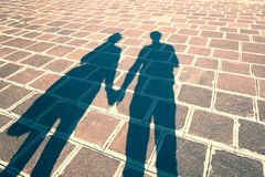 Shadows of couple in love holding hands Royalty Free Stock Image