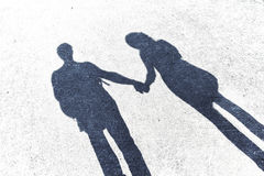 Shadows of couple in love on a walk Royalty Free Stock Photos