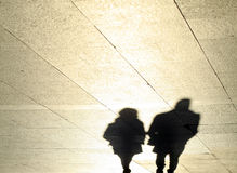 Shadows of a couple reflected royalty free stock photo