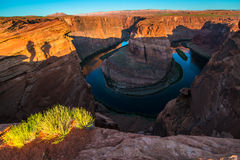 Shadows of couple taking pictures Horseshoe Bend Page Arizona Stock Images