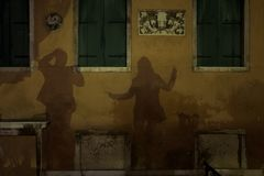 Shadows of dancing couple in Venice stock image
