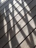 Shadows on the deck Royalty Free Stock Images