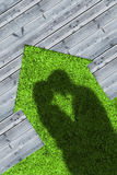 Shadows of embracing couple on wooden boards representing a hous Royalty Free Stock Images