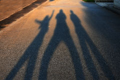 Shadows ending in the blurs. Long shadows from three persons ending in the blurs Royalty Free Stock Photography