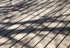 Shadows falling on weathered timber boards Royalty Free Stock Photos