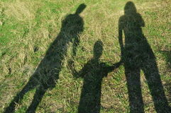 Shadows of the family Royalty Free Stock Image