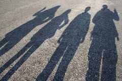 Shadows of family on the beach Royalty Free Stock Images