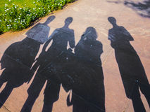 Shadows of family visiting a landmark in Delhi Stock Images