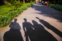 Shadows of family visiting a landmark in Delhi Stock Photography