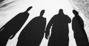 Shadows of four people Royalty Free Stock Images