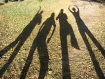 The shadows of friends Stock Photos