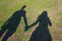 Shadows of friends on the grass Stock Photo