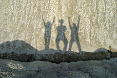 Shadows of friends Stock Images