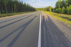 Shadows from a group of people on the highway. Stock Photos