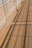 Shadows from a handrail. On the deck of the ship Stock Photography
