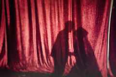 Shadows from the kissing couple on red fabric. Shadows from the kissing couple on the red fabric Stock Photos