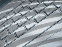 Shadows on laptop keyboard Royalty Free Stock Image