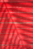 Shadows of leaves on red lath. Wood Stock Images