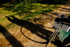 The shadows of lovely couple standing near the bicycle Royalty Free Stock Photo
