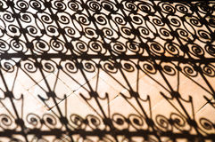 Shadows of moroccan ironwork. Abstract design image of moroccan wrought iron grille Royalty Free Stock Photography