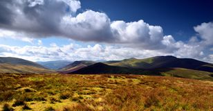 Shadows over Skiddaw Forest fells. Dark shadows sliding over Skiddaw and the Cumbria Way Royalty Free Stock Photography
