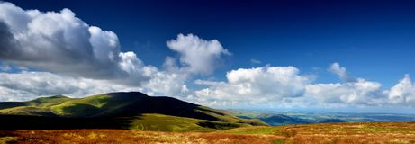 Shadows over Skiddaw Forest fells. Dark shadows sliding over Skiddaw and Great Calva Royalty Free Stock Photography