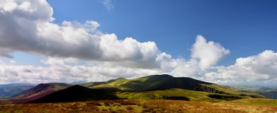 Shadows over Skiddaw Forest fells. Dark shadows sliding over Skiddaw and Great Calva Royalty Free Stock Images