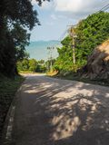 Shadows from palm trees on the road of the island of Phangan stock photo