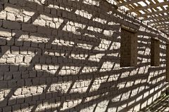 Shadows on a mud brick wall in Kazakhstan. Shadows and patterns on a mud brick wall in Kazakhstan Royalty Free Stock Photography