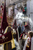 Shadows of penitents on Holy week procession Royalty Free Stock Photo