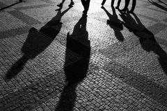 Shadows of people. Walking in a street of the city, Prague, September 2010 Stock Photos