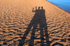 Shadows people on the beach Royalty Free Stock Photography