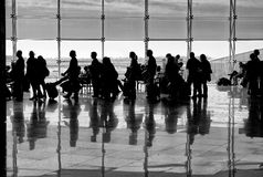 Shadows of people on building background. People shadows with reflection on the ground. Artistic photo in black and white, B&W Royalty Free Stock Photography
