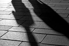 Shadows of people in the city. Shadows of people walking in an open square in the city center Stock Images