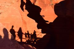 Abstract people`s shadows. Shadows of people entrancing a lower Antelope Canyon Stock Photo