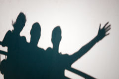 Shadows of people gesturing Royalty Free Stock Photo