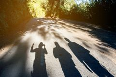 Shadows of people on a hill. Shadows of people on a hill Royalty Free Stock Photography