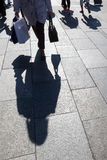 Shadows of people on the move in the city Royalty Free Stock Photo