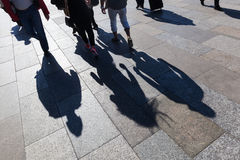 Shadows of people on the move in the city Royalty Free Stock Photos