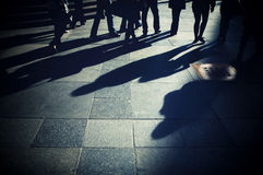 Shadows of people on the pavement Royalty Free Stock Photos