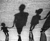 Shadows of people on road Royalty Free Stock Photos